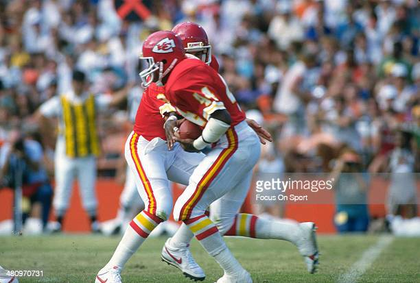 Herman Heard of the Kansas City Chiefs carries the ball against the Miami Dolphins during an NFL Football game December 24 1989 at Joe Robbie Stadium...