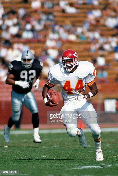 Herman Heard of the Kansas City Chiefs carries the ball against the Los Angeles Raiders during an NFL Football game October 15 1989 at The Los...