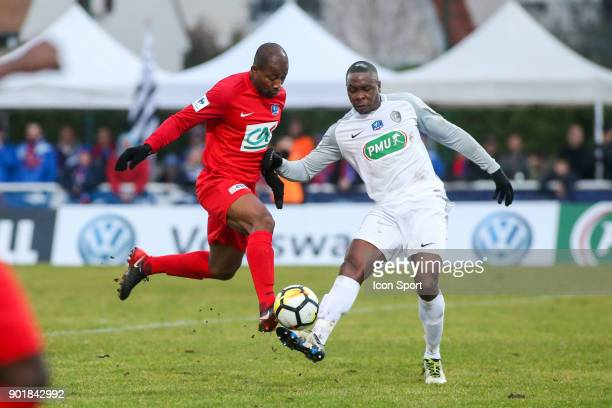 Herman Kore of Concarneau and Teddy Gadjard of Houilles during the french National Cup match between Houilles and Concarneau on January 6 2018 in...