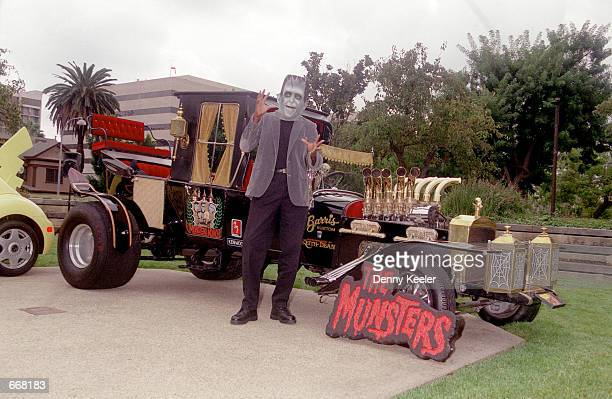 Herman Munster character poses in front of the Munster Koach designed by Star Car creator George Barris at George Barris'' Halloween Bash 2000 Car...