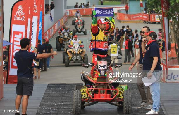 Herman Paredes from Bolivia is pictured on the podium during the start of the 2018 Dakar Rally ahead of the rally's LimaPisco Stage 1 in Lima on...