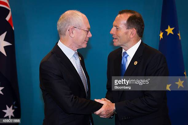 Herman Van Rompuy president of the European Union left and Tony Abbott Australia's prime minister shake hands during a bilateral meeting at the Group...