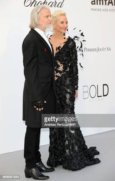 Hermann Bühlbecker and Anne Heche arrive at the amfAR Gala Cannes 2018 at Hotel du Cap-Eden-Roc on May 17, 2018 in Cap d'Antibes, France.