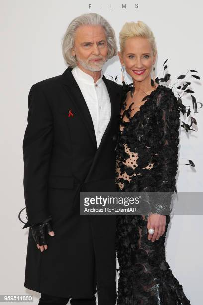 Hermann Buehlbecker and Anne Heche arrive at the amfAR Gala Cannes 2018 at Hotel du Cap-Eden-Roc on May 17, 2018 in Cap d'Antibes, France.
