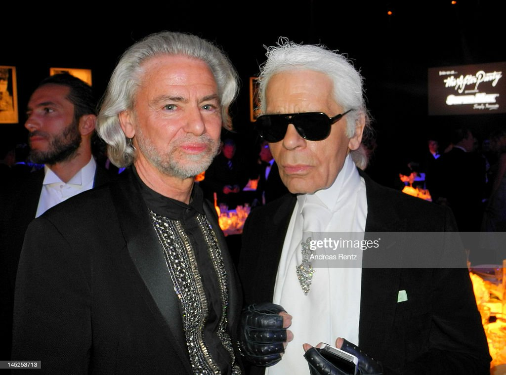 Hermann Buehlbecker and Karl Lagerfeld during the 2012 amfAR's Cinema Against AIDS during the 65th Annual Cannes Film Festival at Hotel Du Cap on May 24, 2012 in Cap D'Antibes, France.
