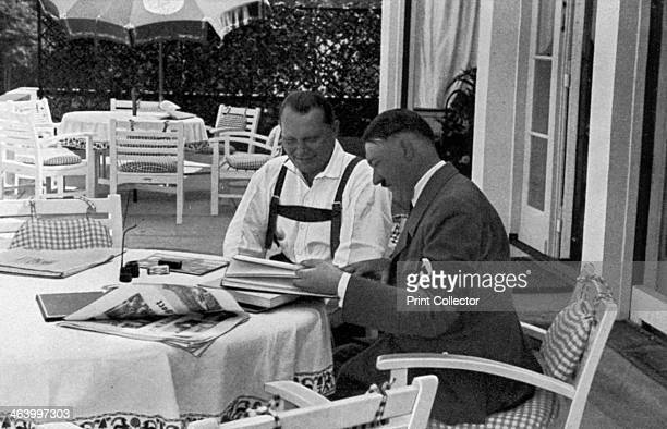 Hermann Goering and Adolf Hitler at his residence in Obersalzberg Bavaria Germany 1936 Goering and Nazi leader Hitler relaxing at Hitler's mountain...