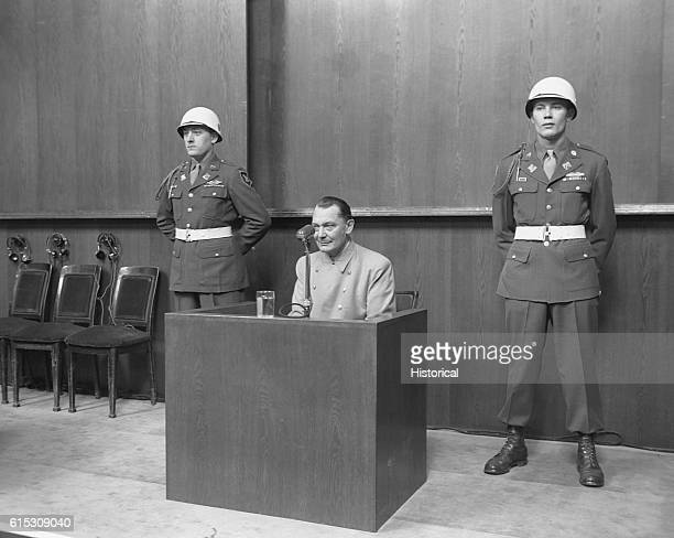Hermann Goering founder of the Gestapo and former head of the Luftwaffe testifies from the witness stand at the Nuremberg war crimes trials flanked...