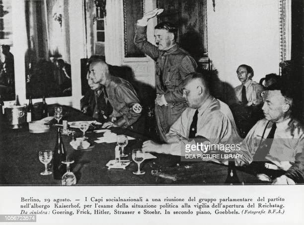 Hermann Goering Wilhelm Frick Adolf Hitler Gregor Strasser and Willi Stoehr with Joseph Goebbels in the background National Socialist parliamentary...
