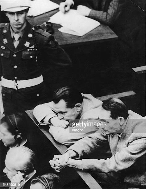 Hermann Göring and Rudolf Hess on the first day of the trial against leading Nazi figures for war crimes and crimes against humanity at the...