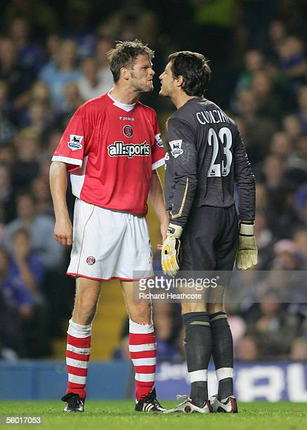 Hermann Hreidarsson of Charlton and Chelsea's Carlo Cudicini exchange words after a goal mouth clash during the Carling Cup Third Round match between...