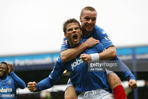 Hermann Hreidarsson of Portsmouth celebrates scoring the opening goal of the match during the Barclays Premier League match between Portsmouth and...