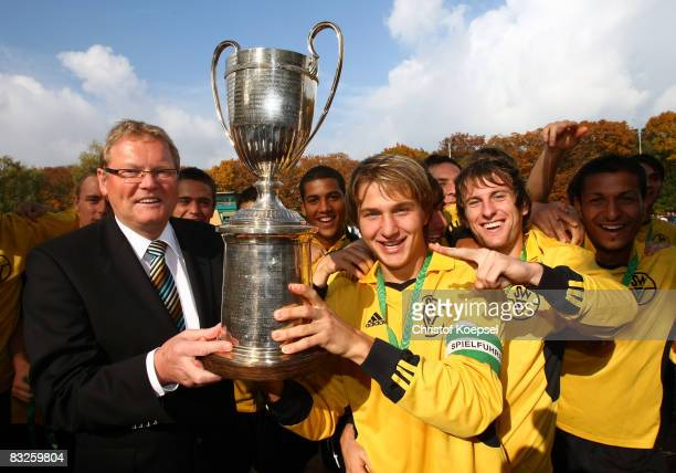 Hermann Korfmacher German Football Association vice president gives out the winning trophy to Mathaeus Gornik of the team Southwest during the U21...