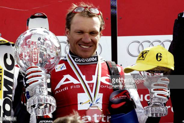 Hermann Maier of Austria celebrates after claiming the FIS Ski World Cup Overall Globe and Super Giant Slalom Globe March 14, 2004 in Sestrieres,...