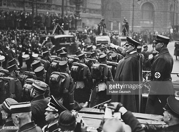 Hermann Wilhelm Goering German Field Marshal Prussian Premier and commander of the German air force salutes German Storm Troopers marching past the...