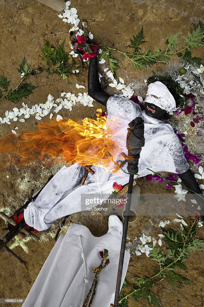 Hermes Cifuentes, a Colombian spiritual healer, performs a ritual of exorcism on Diana R., who claims to be possessed by spirits, on 28 May 2012 in La Cumbre, Colombia. Exorcism is an ancient religious practice of evicting spirits, generally called demons or evil. Although the formal catholic rite of exorcism is rarely seen and must be only conducted by a designated priest, there are many pastors and preachers in Latin America performing exorcism ceremonies. The 52-year-old Brother Hermes, as the exorcist calls himself, claims to have been carrying out the healing rituals for more than 20 years. Using fire, dirt, candles, flowers, eggs and other natural-based items, in conjunction with Christian religous formulas, he attempts to drive the supposed evil spirit out of a victim's mind and body.