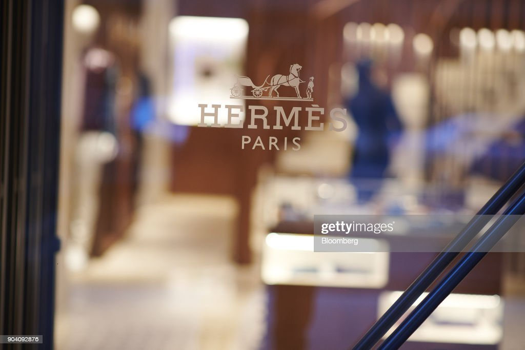 A Hermes logo sits on a window a luxury goods store, operated by Hermes International SCA, in Munich, Germany, on Tuesday, Jan. 9, 2018. The German economy's solid 2017 performance extended into the final three months of the year, with growth of about half a percent. Photographer: Dominik Osswald/Bloomberg via Getty Images