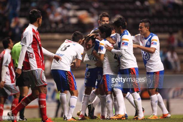 Herminio Miranda of Puebla celebrates a goal during a match between Puebla and Lobos BUAP as part of the Copa MX 2012 at Cuauhtemoc Stadium on August...