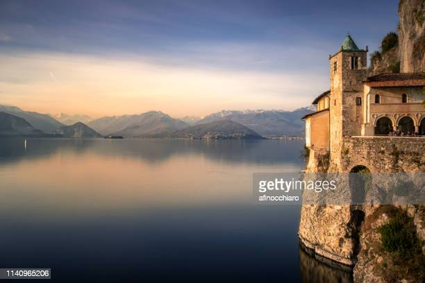 hermitage of santa caterina del sasso by lake maggiore, varese, lombardy, italy - varese stock pictures, royalty-free photos & images