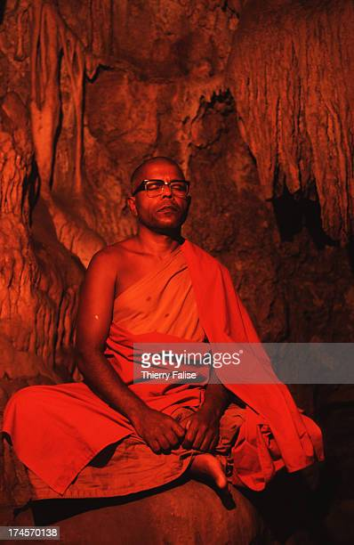 A hermitmonk advocating a return to 'pure Buddhism' is meditating in a cave in a temple in southern Thailand