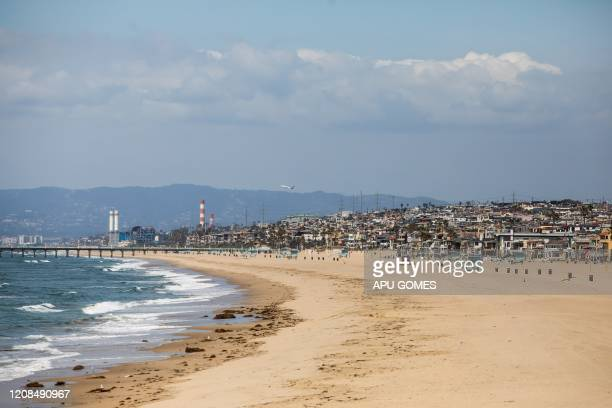 Hermosa Beach is pictured empty in California on March 28, 2020. - Los Angeles County closed all beaches today as a new measure to stem the spread of...
