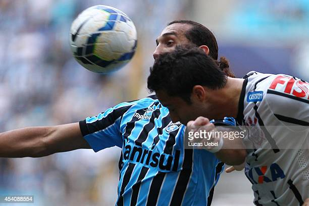 Hernan Barcos of Gremio battles for the ball against Anderson Martins of Corinthians during the match Gremio v Corinthians as part of Brasileirao...