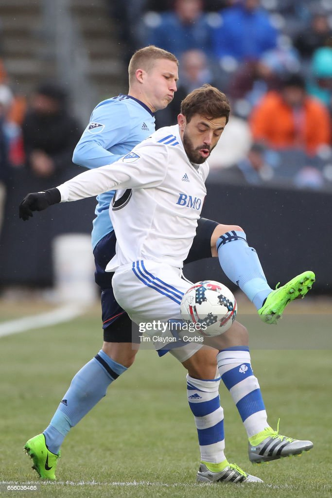 Hernan Bernardello #30 of Montreal Impact is challenged by Alexander Ring #8 of New York City FC during the New York City FC Vs Montreal Impact regular season MLS game at Yankee Stadium on March 18, 2017 in New York City.