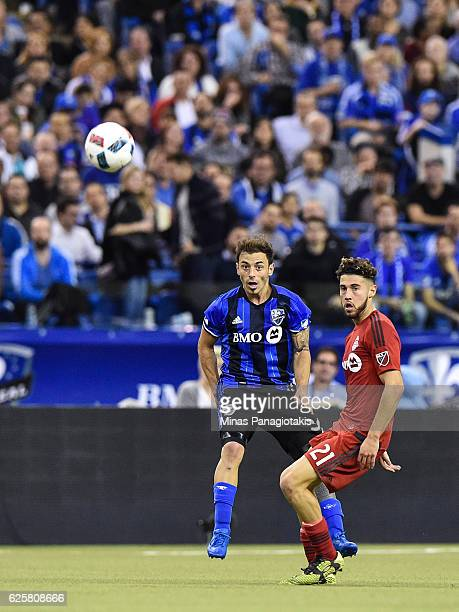 Hernan Bernardello of the Montreal Impact and Jonathan Osorio of the Toronto FC watch the ball during leg one of the MLS Eastern Conference finals at...