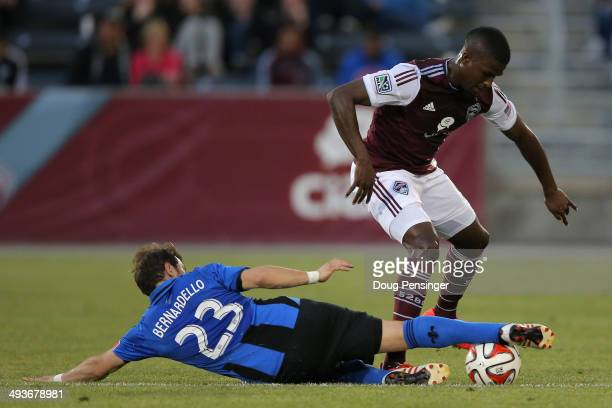 Hernan Bernardello of the Montreal Impact wins the ball away from Edson Buddle of the Colorado Rapids at Dick's Sporting Goods Park on May 24 2014 in...