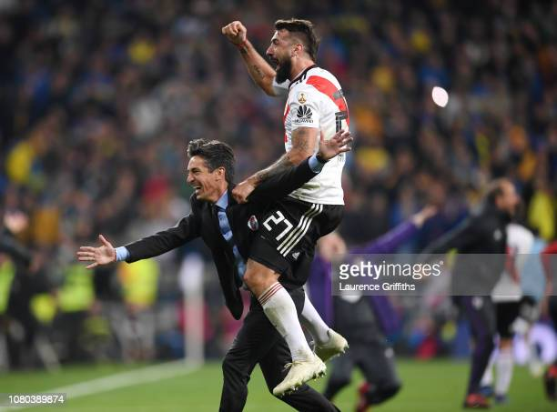 Hernan Bujan, Assistant Manager of River Plate celebrates with Lucas Pratto following their sides victory in during the second leg of the final match...
