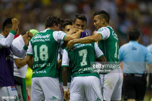 Hernan Burbano of Leon celebrates with teammates after scoring the winning goal of his team during the 11th round match between Leon and America as...