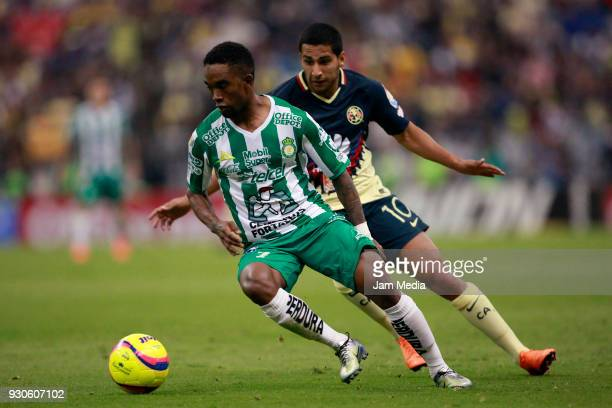 Hernan Burbano of Leon fights for the ball with Cecilio Dominguez of America during the 11th round match between America and Leon as part of the...