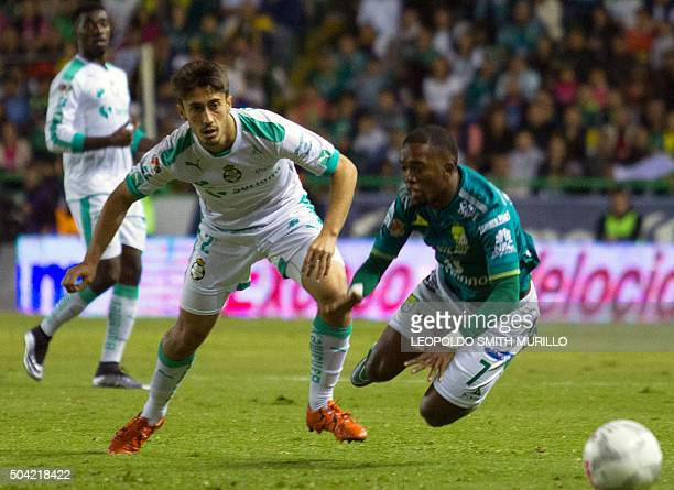 Hernan Burbano of Leon vies for the ball with Jose Abella of Santos during their Mexican Clausura 2016 tournament football match at the Nou Camp...