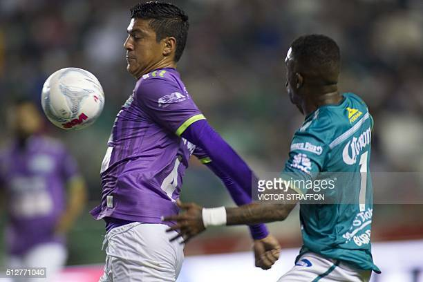 Hernan Burbano of Leon vies for the ball with Luis Venegas of Chiapas during their Mexican Clausura tournament football match at the Nou Camp stadium...