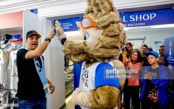 Hernan Crespo former striker of the Argentina national football team poses with mascot Zabivaka as he visits an official FIFA World Cup 2018 shop in...