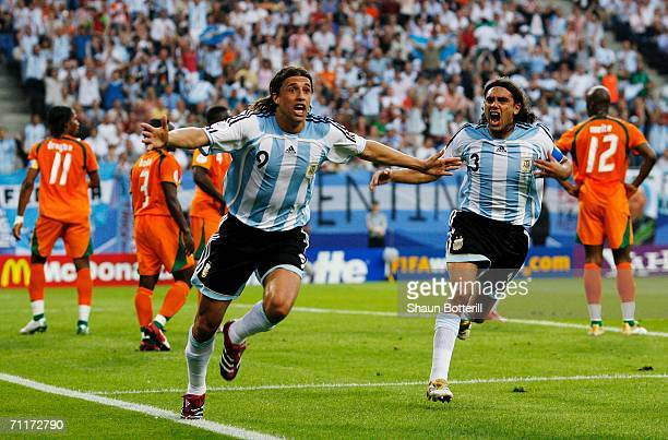 Hernan Crespo of Argentina celebrates scoring his team's first goal with team mate Juan Sorin during the FIFA World Cup Germany 2006 Group C match...