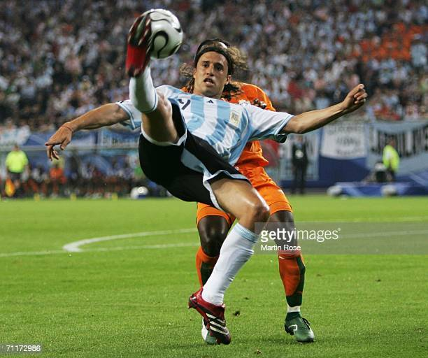 Hernan Crespo of Argentina controls the ball under pressure during the FIFA World Cup Germany 2006 Group C match between Argentina and Ivory Coast...
