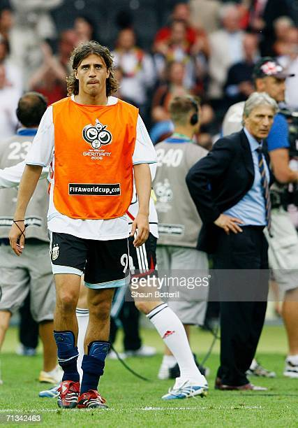 Hernan Crespo of Argentina shows his dejection following his team's defeat at the end of the FIFA World Cup Germany 2006 Quarterfinal match between...