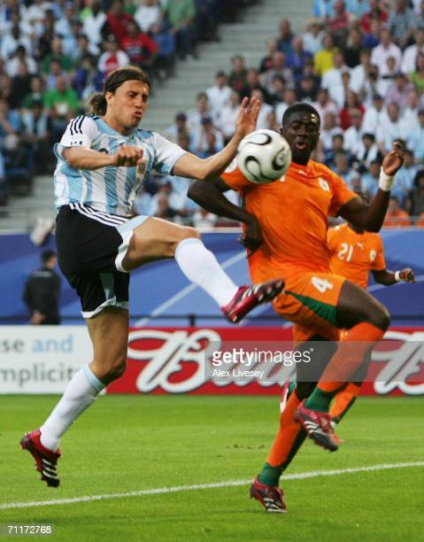 Hernan Crespo of Argentina tries to steer the ball past Kolo Toure of Ivory Coast during the FIFA World Cup Germany 2006 Group C match between...