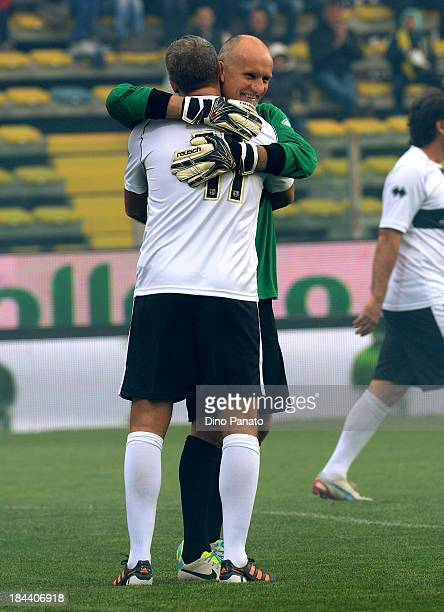 Hernan Crespo of Crociati Parma hugs Claudio Tafarell goalkeeper of Gialloblu Parma during the match between Gialloblu Parma and Crociati Parma for...