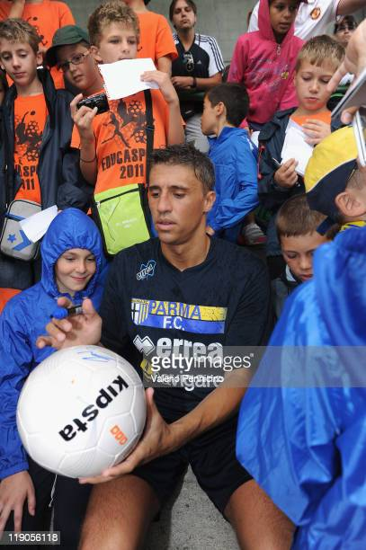 Hernan Crespo of FC Parma signs a ball during a FC Parma training session on July 14 2011 in Levico Terme Trento Italy