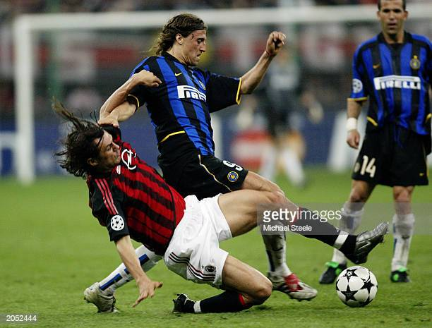 Hernan Crespo of Inter Milan is tackled by Paolo Maldini of AC Milan during the UEFA Champions League SemiFinal First Leg match between AC Milan and...