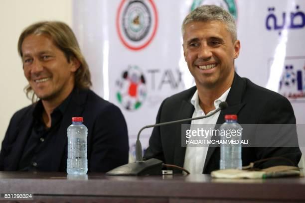 Hernan Crespo retired Argentine footballer and Michel Salgado retired Spanish footballer answer reporters questions at the stadium in Basra on August...