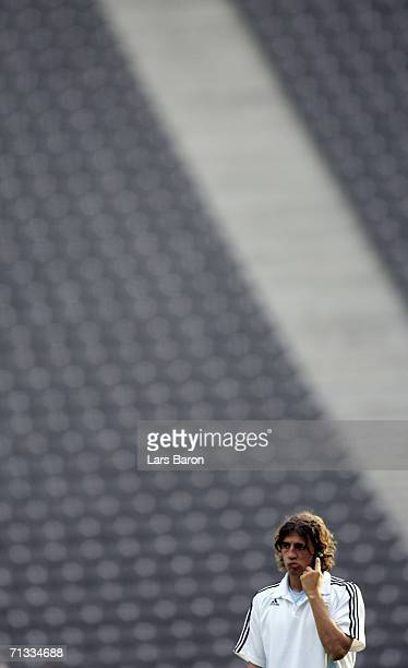 Hernan Crespo speaks on a mobile phone during the Argentina National Football Team training session at the Olympic Stadium Berlin on June 29 2006 in...