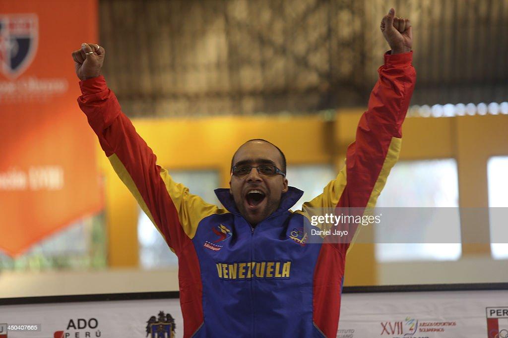 Hernan Jansen, of Venezuela, celebrates on the podium after winning the gold medal in fencing event as part of the XVII Bolivarian Games Trujillo 2013 at Colegio San JosŽ Obrero Coliseum on November 18, 2013 in Trujillo, Peru.
