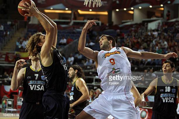 Hernan Jasen of Argentina battles for the ball with Felipe Reyes of Spain at the 2010 World Championships of Basketball during the game between...