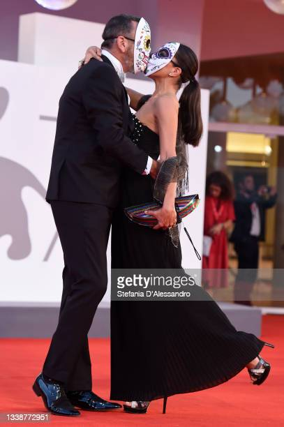 """Hernan Mendoza and a guest attend the red carpet of the movie """"La Caja"""" during the 78th Venice International Film Festival on September 06, 2021 in..."""