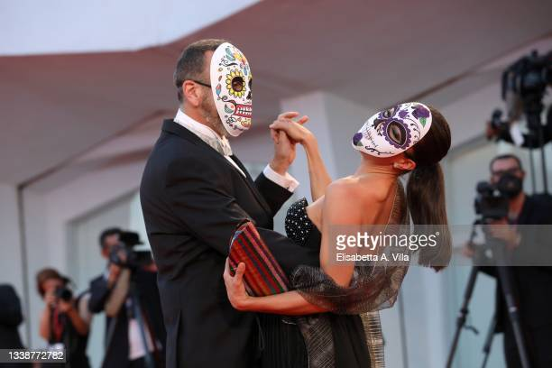 """Hernan Mendoza and a guest wear Mexican death masks as they attend the red carpet of the movie """"La Caja"""" during the 78th Venice International Film..."""