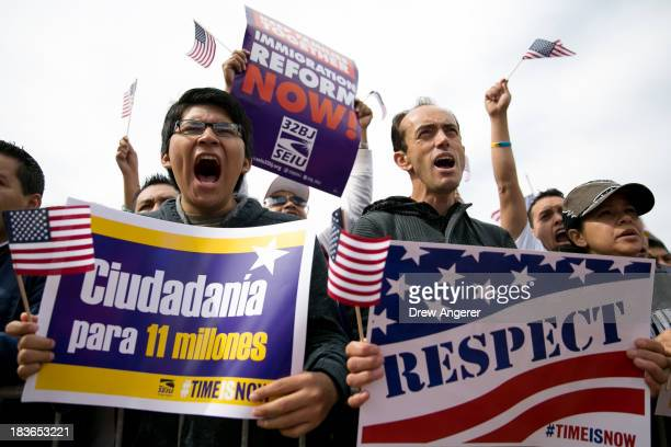 Hernan Morales, a student at American University, and Juan Martinez, cheer during a rally in support of immigration reform, in Washington, on October...