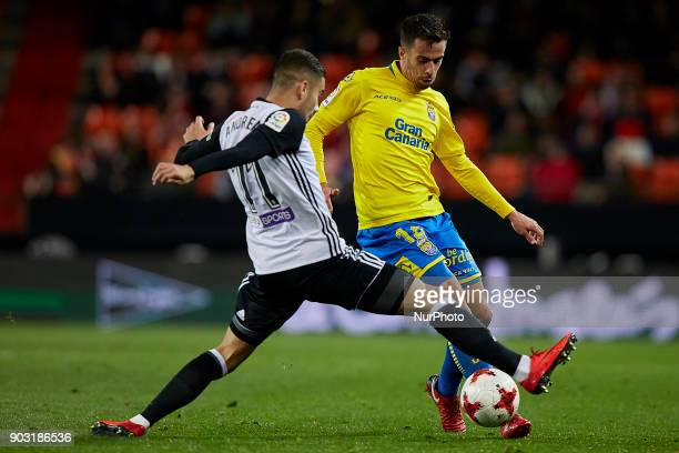 Hernan of UD Las Palmas competes for the ball with Andreas Pereira of Valencia CF during the Copa del Rey Round of 16 second leg game between...