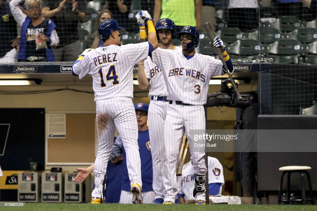 Hernan Perez #14 and Orlando Arcia #3 of the Milwaukee Brewers celebrate after Perez hit a home run in the fifth inning against the Philadelphia Phillies at Miller Park on June 15, 2018 in Milwaukee, Wisconsin.